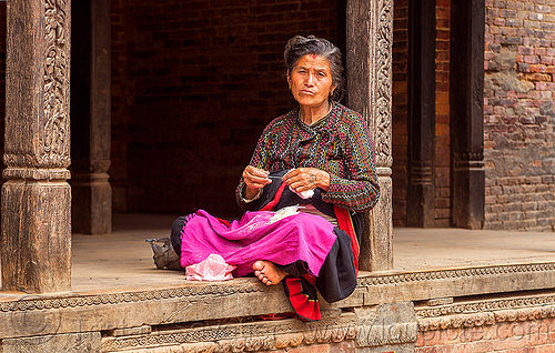 nepali hindu woman sitting in a pati (nepal), bhaktapur, pati, pillars, sitting, woman, wood carving, wooden