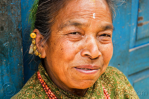 nepali hindu woman with multiple helix ear piercings and gold earrings (nepal), bhaktapur, ear piercing, earrings, helix piercing, jewelry, tilak, woman