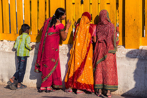 nepali women in sari looking through temple fence (nepal), boy, budhanikantha temple, child, fence, kid, red, sarees, saris, standing, women