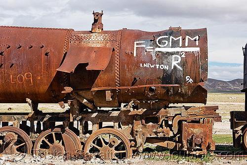 newton's universal law of gravitation equation - graffiti on steam locomotive, bolivia, enfe, equation, fca, graffiti, gravitation, newton, physics, railroad, railway, rusty, science, scrapyard, steam engine, steam locomotive, steam train engine, train cemetery, train graveyard, train junkyard, uyuni