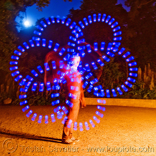 nicky spinning blue LED light poi - flowlights (san francisco), fire dancer, fire dancing, fire performer, fire spinning, flowtoys, glowing, led lights, led poi, led staff, light staffs, long exposure, nicky evers, night, people, spinning fire