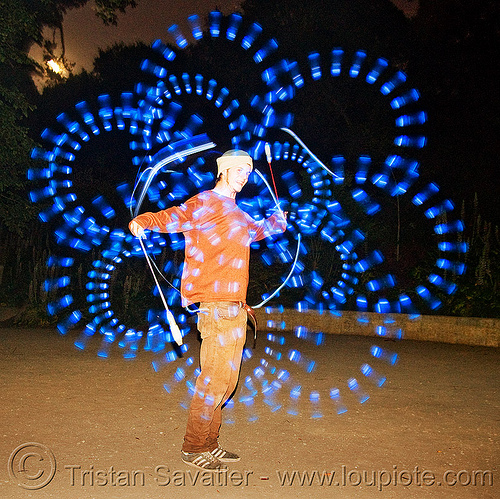 nicky spinning LED light poi - flowlights, fire dancer, fire dancing, fire performer, fire spinning, flowlights, flowtoys, glowing, led lights, led poi, led staff, light poi, light staffs, long exposure, nicky evers, night, spinning fire