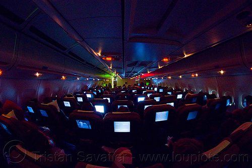 night flight - airbus A340 passenger cabin - glowing screens, airbus a340, flight lx-39, glowing, inside, interior, night, passenger cabin, passenger plane, swiss air, swiss international air lines, vanishing point, video screens