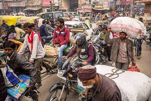 normal traffic jam in busy street (india), bicycles, bikes, carrying, cars, crowd, cycle rickshaws, gridlock, motorbikes, motorcycles, sacks, street, traffic jam, varanasi
