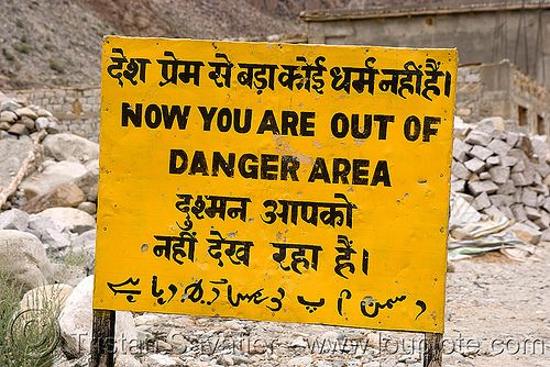 now you are out of danger area - sign - leh to srinagar road - kashmir, arabic, bro road signs, danger area, hazard, hindi, india, kashmir, road sign, urdu script, urdu writing
