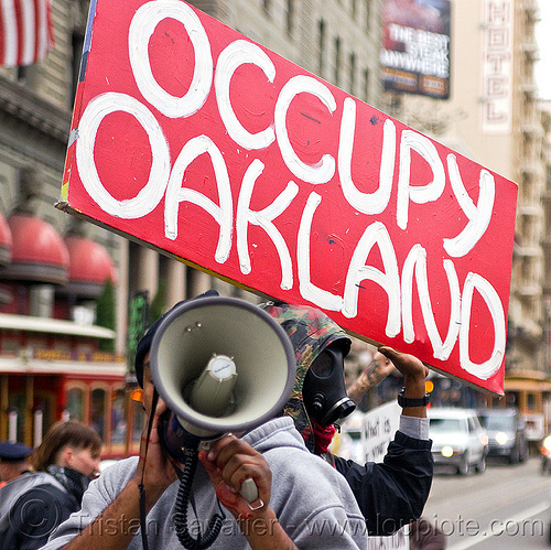 occupy oakland, black friday, bullhorn, demonstration, demonstrators, gas mask, ows, people, protest, protesters, sign, street, union square