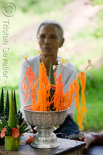 offering - wat phu champasak (laos), flowers, hindu temple, hinduism, khmer temple, offerings, old woman, orange, ruins, wat phu champasak, wool