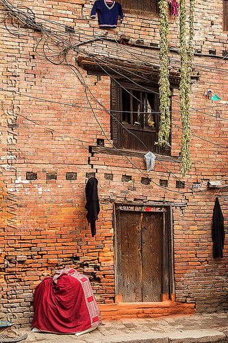 old brick house with cracks in wall (nepal), bhaktapur