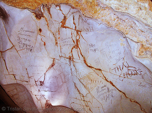 old graffiti from french sailors in cave on desert island - vietnam, cat ba island, caving, cát bà, georges leygues, graffiti, halong bay cave, natural cave, rock, spelunking