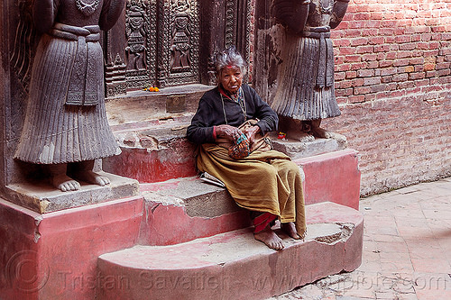 old nepali hindu woman on temple steps - bhaktapur durbar square (nepal), bhaktapur, durbar square, hindu, hinduism, old woman, sitting, steps, tilak