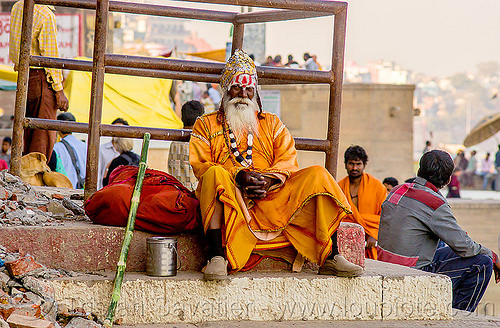 old sadhu sitting on a ghat - varanasi (india), baba, bhagwa, ghats, hat, headdress, hindu, hinduism, india, man, necklace, sadhu, saffron color, sitting, tilak, turban, varanasi, white beard