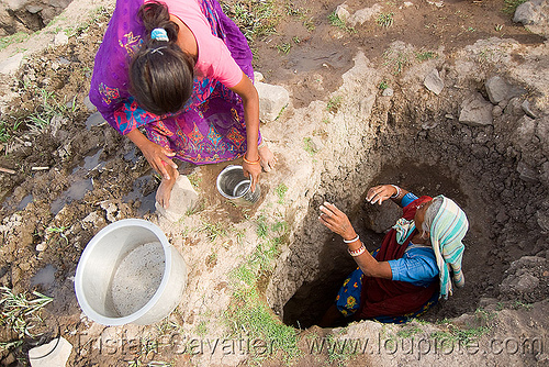 old woman getting drinking water from water hole - mandu (india), india, mandav, mandu, water hole, woman