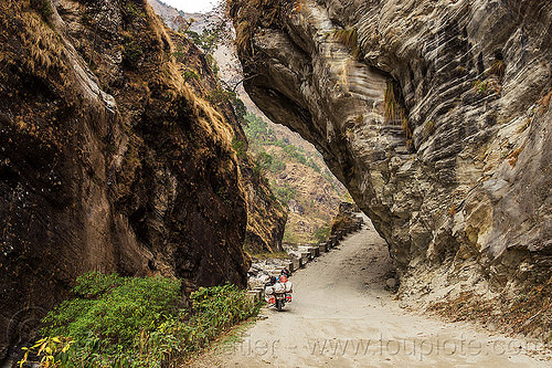 overhanging rock in narrow gorge near tatopani - road between beni and jomsom (nepal), annapurnas, canyon, cliff, dirt road, gorge, kali gandaki valley, motorcycle touring, mountain road, mountains, overhanging rock, unpaved