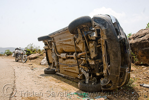 overturned car on its side, car accident, crash, kashmir, overturned car, road, rollover, tata indica, tata motors, traffic accident, underbelly, white, wreck