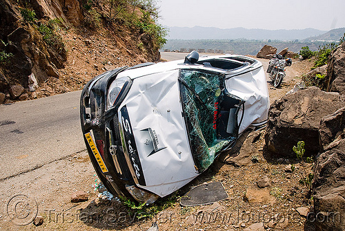 overturned car - indica DLE, car accident, crash, kashmir, overturned car, road, rollover, tata indica, tata motors, traffic accident, white, wreck