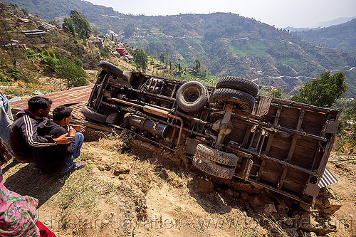 overturned truck in ditch off mountain road (nepal), crash, ditch, lorry, mountain road, overturned, rollover, tata motors, traffic accident, truck accident, underbelly, up-side-down, wreck