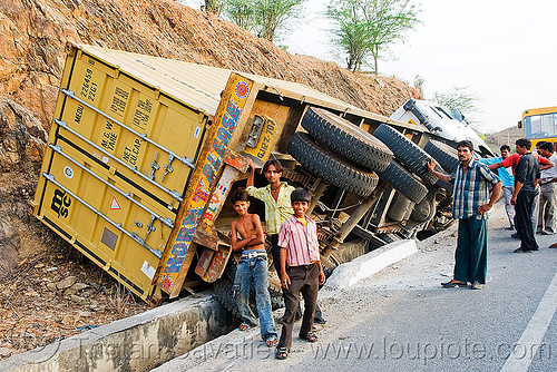 overturned truck (india), crash, ditch, india, lorry, men, overturned truck, road, rollover, tata motors, traffic accident, truck accident, wreck