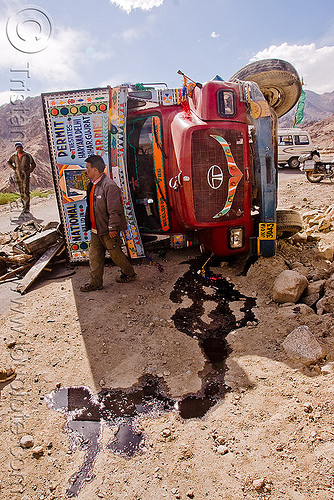 overturned truck - khardungla pass - ladakh (india), crash, environment, india, khardung la pass, ladakh, lorry, men, mountain pass, oil spill, overturned truck, pollution, road, rollover, tata motors, traffic accident, truck accident, wreck