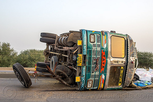 overturned truck on highway median (india), cargo, crash, freight, india, load, lorry, overturned, rice bags, road, rollover, spilled, tata motors, traffic accident, truck accident, wreck