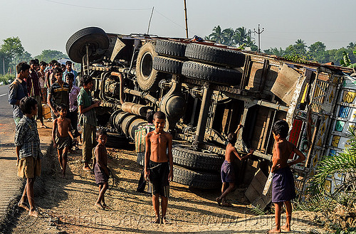overturned truck on road side (india), accident, boys, children, crash, crowd, lorry, men, people, rollover, tata, tata motors, traffic accident, truck accident, underbelly, wreck