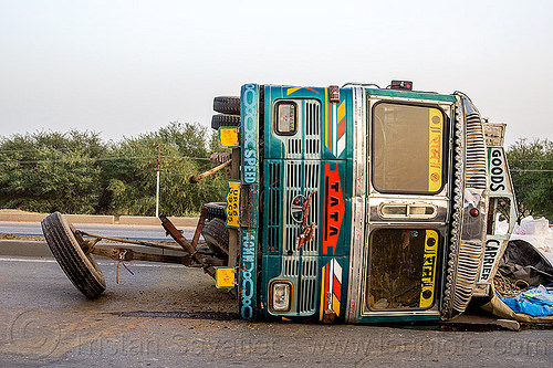 overturned truck with front wheels ripped off (india), crash, lorry, median, overturned, road, rollover, tata motors, traffic accident, truck accident, wheel, wreck