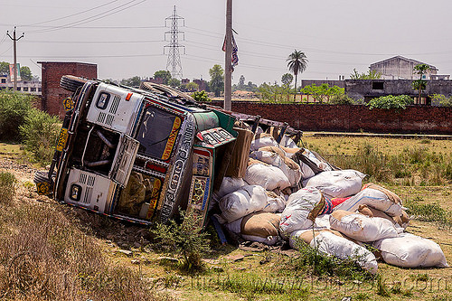 overturned truck with spilled cargo (india), 2515 cex, cargo, crash, freight, india, load, lorry, overturned, road, rollover, sacks, spilled, tata motors, traffic accident, truck accident, wreck