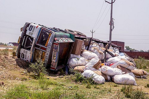 overturned truck with spilled load (india), 2515 cex, cargo, crash, freight, india, load, lorry, overturned, road, rollover, sacks, spilled, tata motors, traffic accident, truck accident, wreck