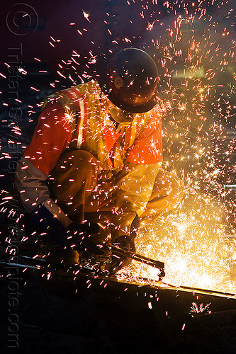 oxy-acetylene cutting torch, construction, dust mask, helmet, high-visibility jacket, high-visibility vest, light rail, man, muni, night, ntk, oxy-fuel, oxy-fuel cutting, people, railroad, railroad construction, railroad tracks, rails, railway, railway tracks, reflective, reflective jacket, reflective vest, safety helmet, safety vest, san francisco municipal railway, sparks, track maintenance, track work, welder, worker, working