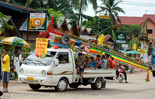 parading the giant bamboo fireworks rocket - vang vieng (laos), bamboo rocket, fireworks, laos, parade, pyrotechnics, vang vieng