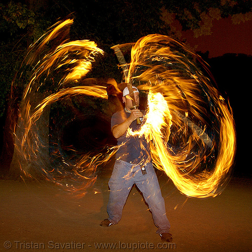 paramedic spinning fire swords (san francisco), fire dancer, fire dancing, fire performer, fire spinning, fire swords, flames, long exposure, night, spinning fire