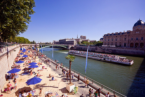 paris plage, bateau mouche, beach umbrellas, beachgoers, bridge, crowd, palmtree, paris plage, pont notre dame, river bank, river boat, sand, seine, ship, sightseeing boat, summer, tourists, tree, vacations, voie sur berge, water