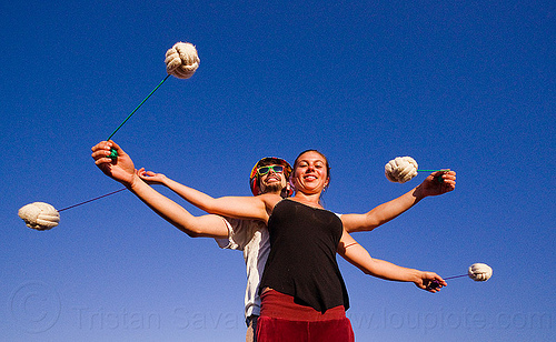 partner poi - two people spinning poi together, ball, blue sky, cary, man, partner poi, rope, savanna, training poi, woman