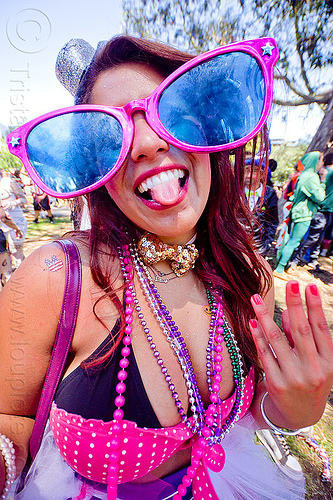 party girl  with oversize party sunglasses, bay to breakers, beads, footrace, necklaces, novelty sunglasses, oversize sunglasses, panhandle, raver, sticking out tongue, sticking tongue out, street party, woman