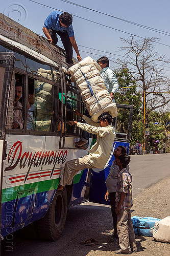 passenger loading luggage on indian bus - pushing large bundle over the head (india), bundle, bus, carrying on the head, freight, india, load, loading, luggage, men, passengers