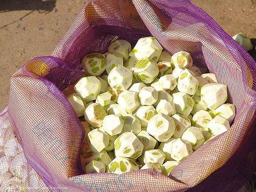 peeled limes in bag - thailand, bag, citrus, farmers market, fruits, lemons, limes, peeled, skinned, thailand