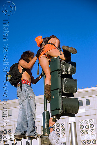 people climbing on traffic lights - lovefest  (san francisco), climbing, guy, lovevolution, man, traffic light, woman