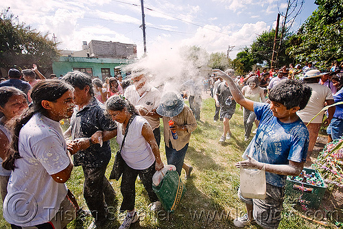 people dancing around the apacheta - carnaval - carnival in jujuy capital (argentina), andean carnival, carnaval, crowd, jujuy capital, noroeste argentino, san salvador de jujuy, talk powder