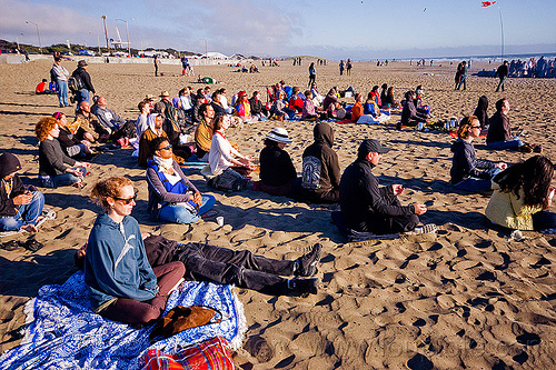 people meditating on beach during solar eclipse (san francisco), crowd, man, meditating, meditation, ocean beach, sand, sitting, solar eclipse