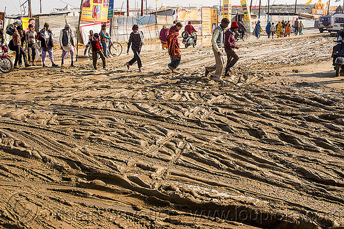 people walking on muddy road (india), hindu, hinduism, intersection, kumbha mela, maha kumbh mela, mud ruts, muddy road, muddy street, walking