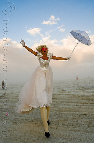 performer on stilts - jesster - burning man 2009, burning man, circus metropolus, jessica, jesster, stilts, stiltwalker, stiltwalking, umbrella