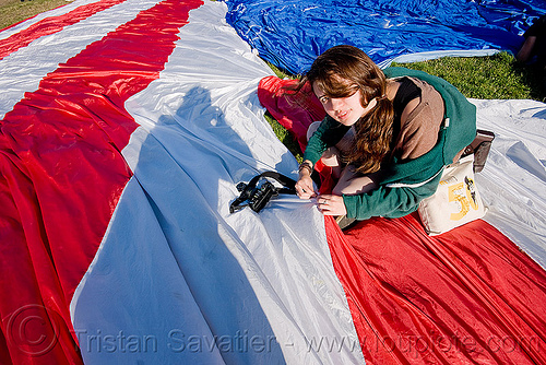 phoebe sewing the giant american flag - dolores park (san francisco), american flag, camera, giant flag, mending, phoebe, photographer, sewing, stitching, the flag project, us flag, woman
