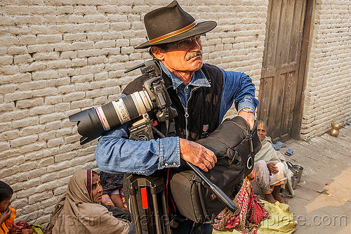 photographer with canon camera and tripod, canon camera, fedora hat, hindu, hinduism, kathmandu, maha shivaratri, man, pashupatinath, photographer, telephoto lens, tripod