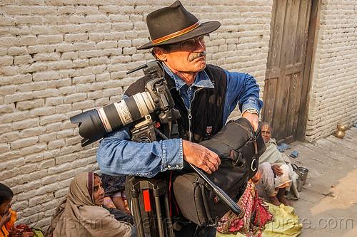 photographer with canon camera and tripod, canon camera, fedora hat, festival, hindu, hinduism, kathmandu, maha shivaratri, man, pashupati, pashupatinath, photographer, telephoto lens, tripod