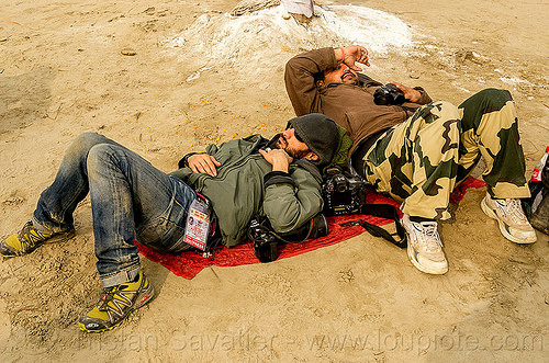photographers napping - jordano cipriani - kumbh mela 2013 festival (india), cameras, hindu, hinduism, jordano cipriani, kumbha mela, lying down, maha kumbh mela, men, napping, press pass, press photographers, resting, sleeping, two