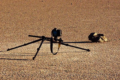 photographing a sailing stone on the racetrack - death valley, camera, death valley, desert, dry lake, dry mud, racetrack playa, sailing stone, sliding rock, tripod