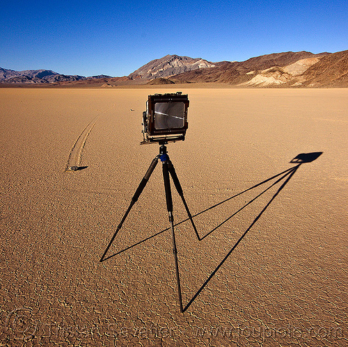 photographing a sailing stone on the racetrack - death valley, death valley, dry lake, dry mud, film camera, large format, mountains, photographic chamber, racetrack playa, sailing stone, sliding rock, tripod