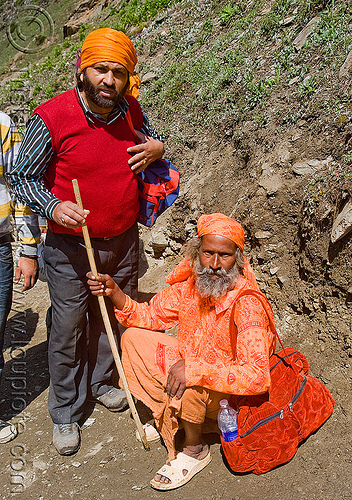 pilgrim and sadhu (hindu holy man) - amarnath yatra (pilgrimage) - kashmir, amarnath yatra, baba, hiking cane, hindu holy man, hindu pilgrimage, hinduism, india, kashmir, mountain trail, mountains, pilgrim, sadhu, trekking, walking stick