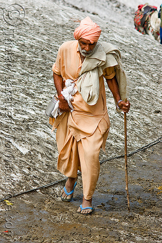 pilgrim in flip-flop shoes on glacier trail - amarnath yatra (pilgrimage) - kashmir, amarnath yatra, flip-flops, glacier, hiking cane, kashmir, mountain trail, mountains, pilgrim, pilgrimage, sandals, trekking, walking stick, yatris, अमरनाथ गुफा
