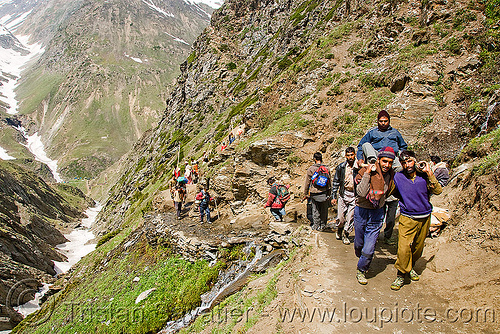pilgrim on dandi / doli (chair carried by 4 porters) - pilgrims on trail - amarnath yatra (pilgrimage) - kashmir, amarnath yatra, bearers, dandi, doli, hiking, hindu pilgrimage, india, kashmir, men, mountain trail, mountains, pilgrims, porters, trekking, wallahs