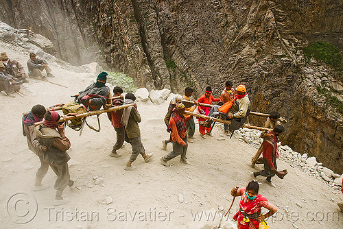pilgrims on dandis / dholis (chairs carried by 4 porters) - amarnath yatra (pilgrimage) - kashmir, amarnath yatra, bearers, dandis, dolis, kashmir, men, mountain trail, mountains, pilgrimage, pilgrims, porters, trekking, wallahs, yatris, अमरनाथ गुफा